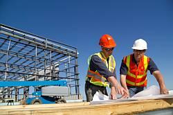 Overleg op de bouwplaats